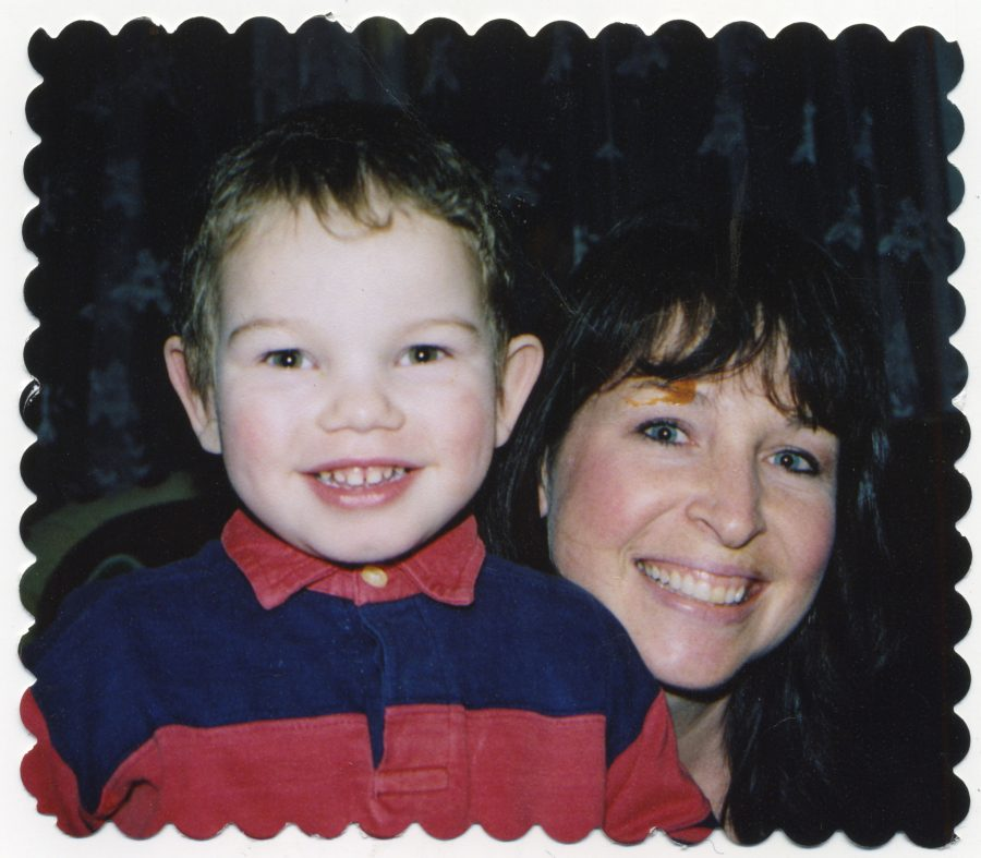 Max Megushar smiles next to his mom Beth Meguschar, an  assisatant principal at NHS. Beth met Max at an orphanage in  Tikhvin, Russia before Beth returned to adopt him.