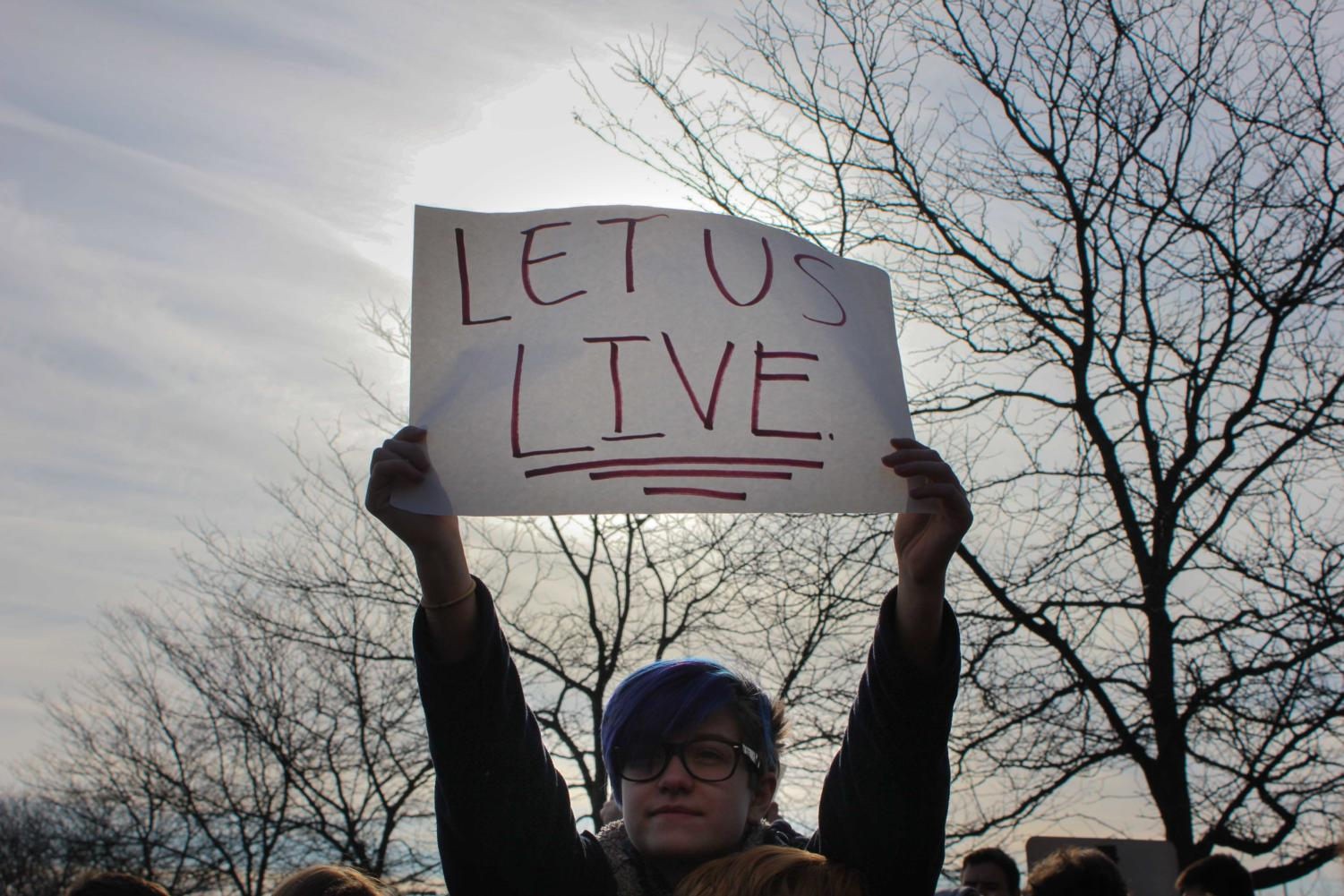 A student holds up a sign during the walkout.