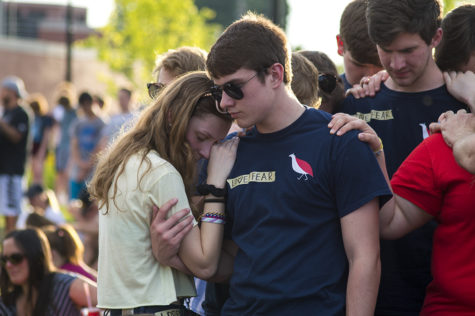 Sophomore Grace Pearson and freshman Holden Montarsi pray together.