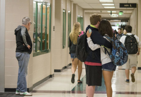 A couple hugs in the hallway before they part ways.