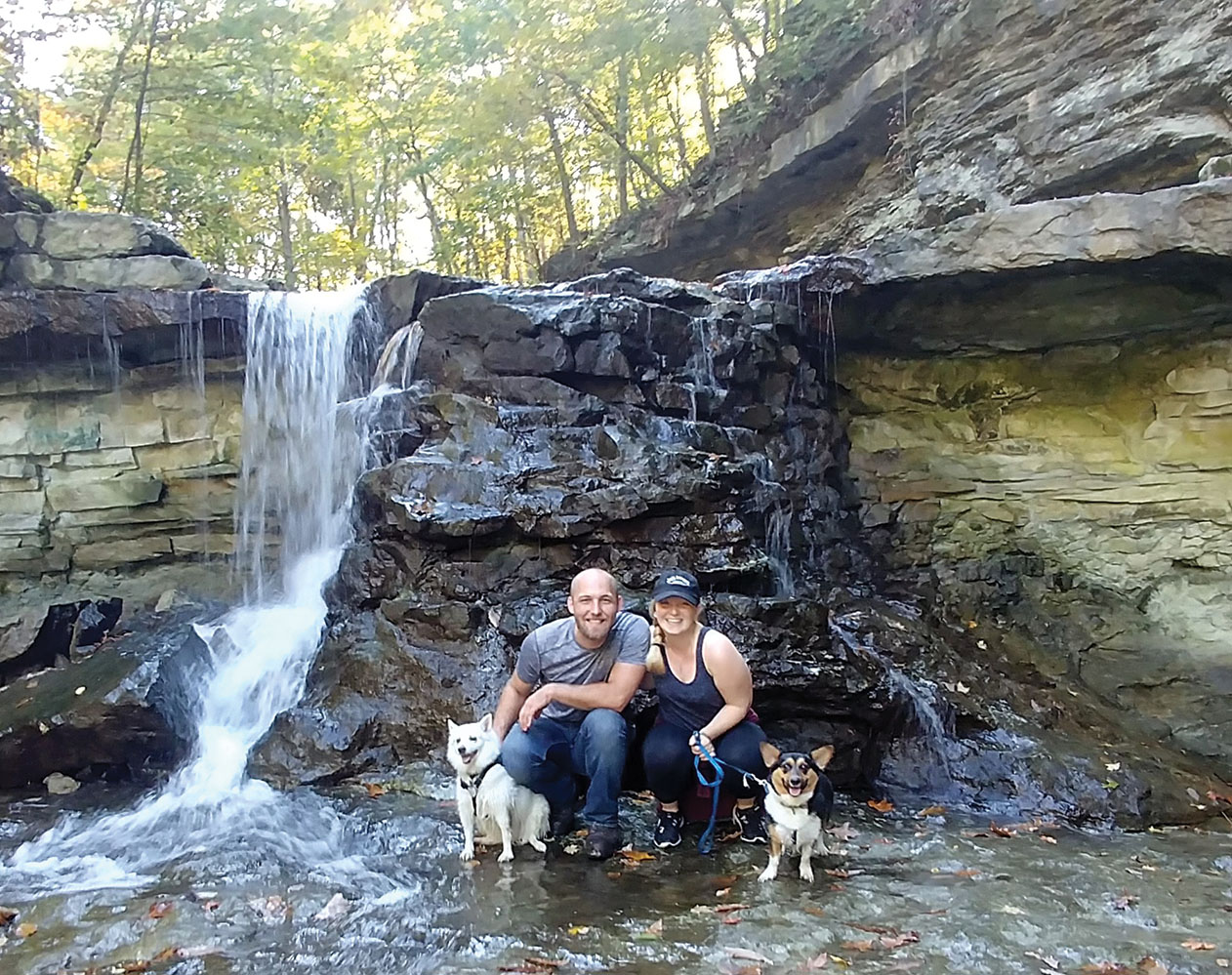 O'Neal camping with her two dogs and her husband. O'Neal went hiking with her husband and her two dogs and found a waterfall.