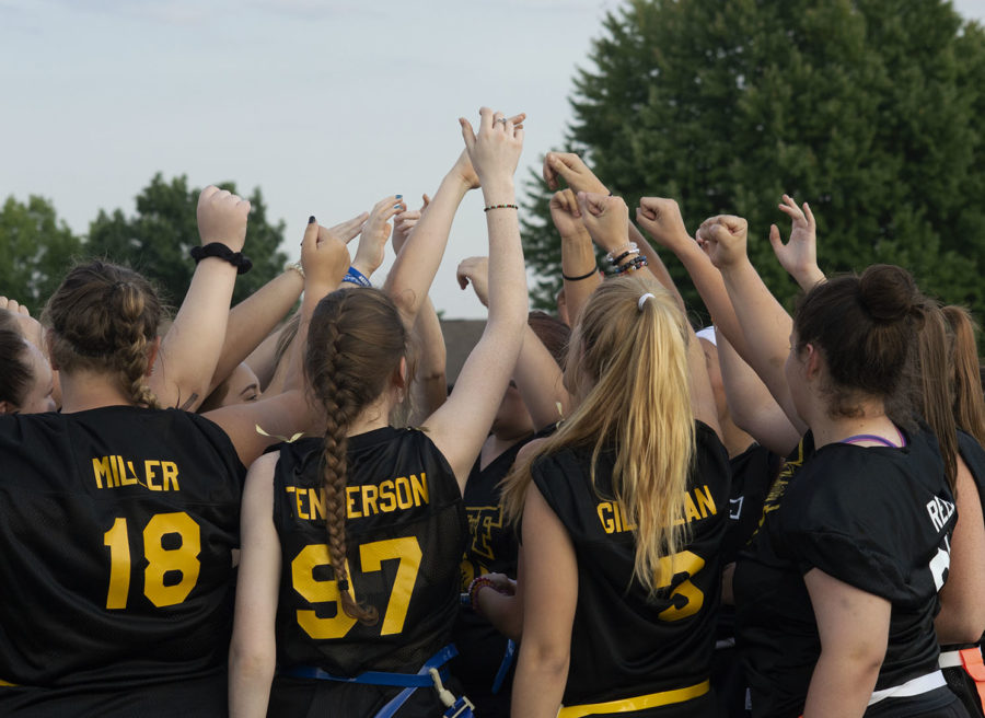 The senior powderpuff team comes together before the game.