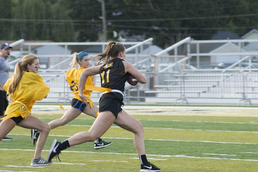 Senior Maddie Knight runs through an opening to score a touchdown.