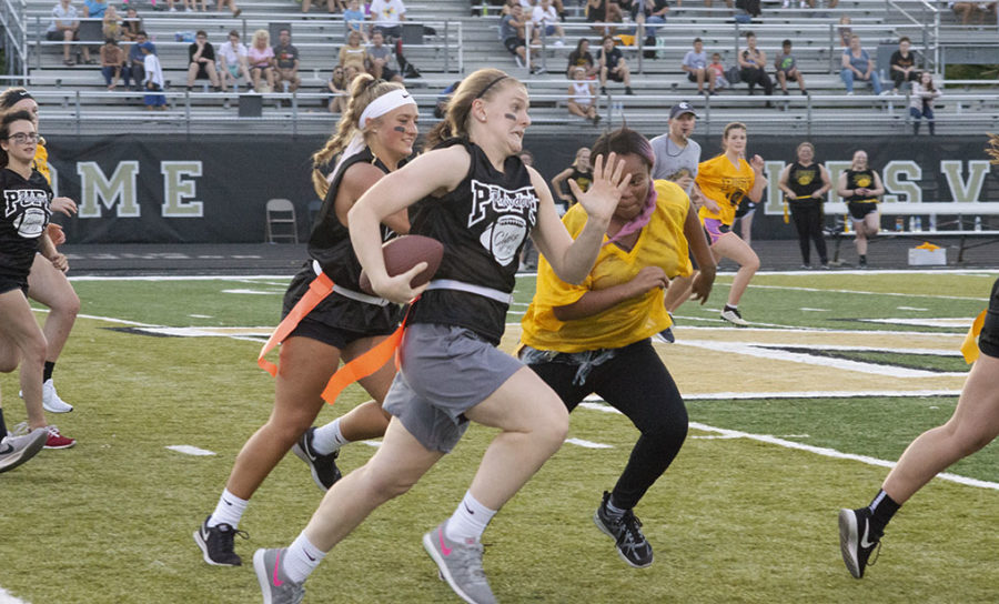 Senior Madison Whetro sprints down the field for a touchdown.