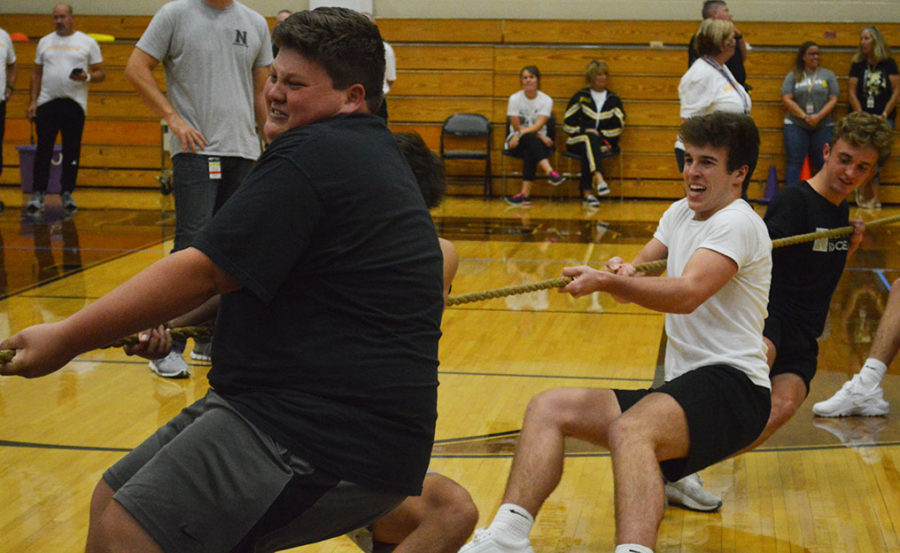 Junior Kyle Bilby fights in front with other junior boys to win the tug of war during the Mini Olympics.