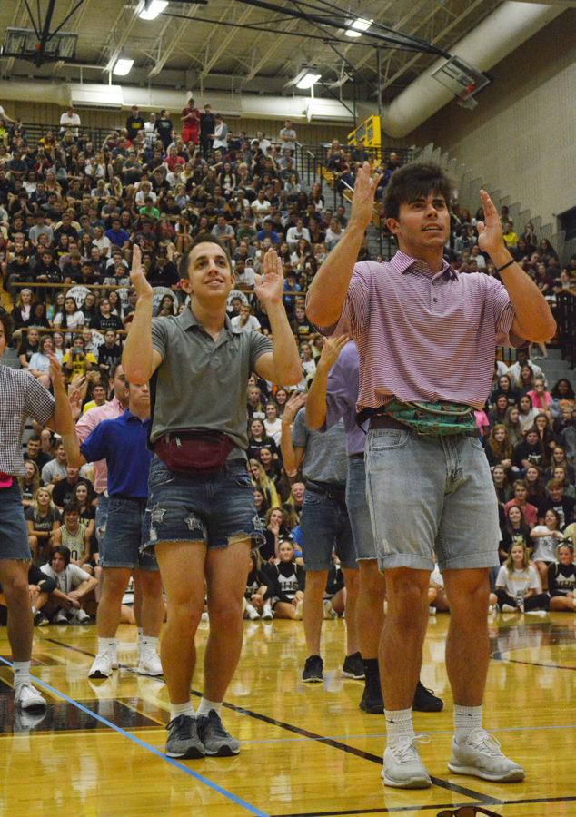Seniors DJ Owens and Jackson Costa dance during the Mini Olympics.