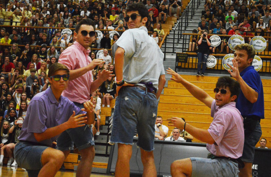 Seniors Eagan Keever-Hill, DJ Owens, Grant Welcher, Josh Lewis, and Tyler Cassidy pose during the Mini Olympics dance.