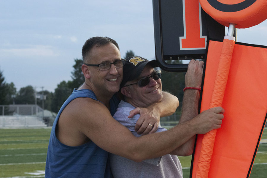 Resource teacher Kurt Gassensmith and History teacher Butch Robinson make the most out of the powderpuff game.