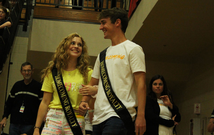 Seniors Braedon Gossard and Natalie Grubb walk into the gym as they are introduced for Homecoming Court.