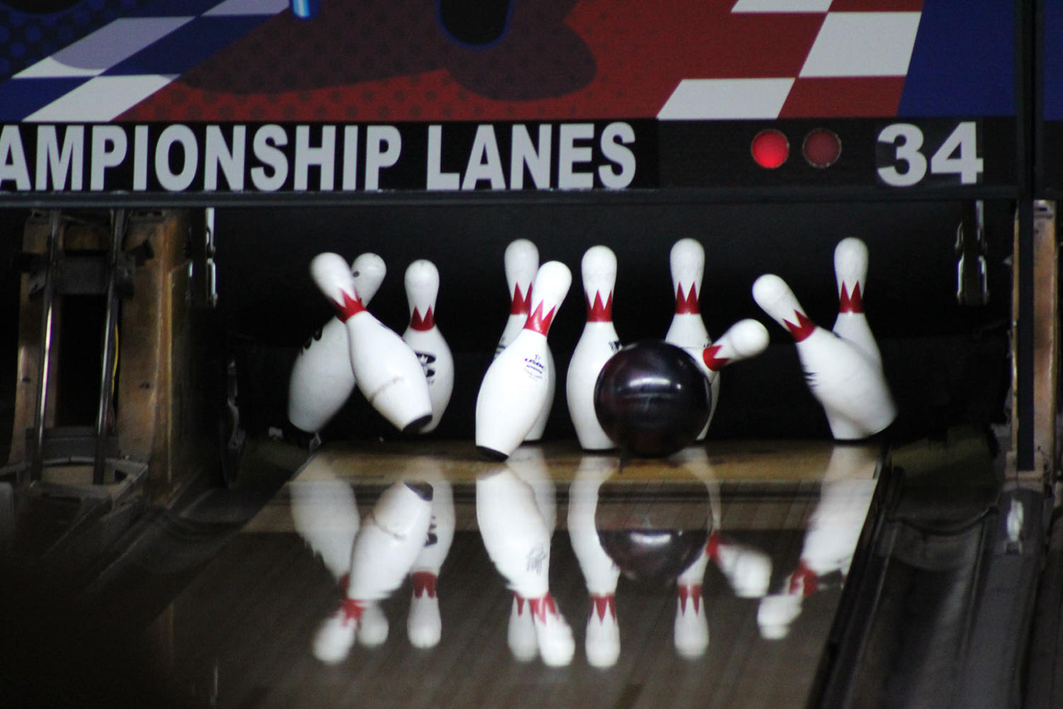 One NHS bowling teammate goes for a strike.