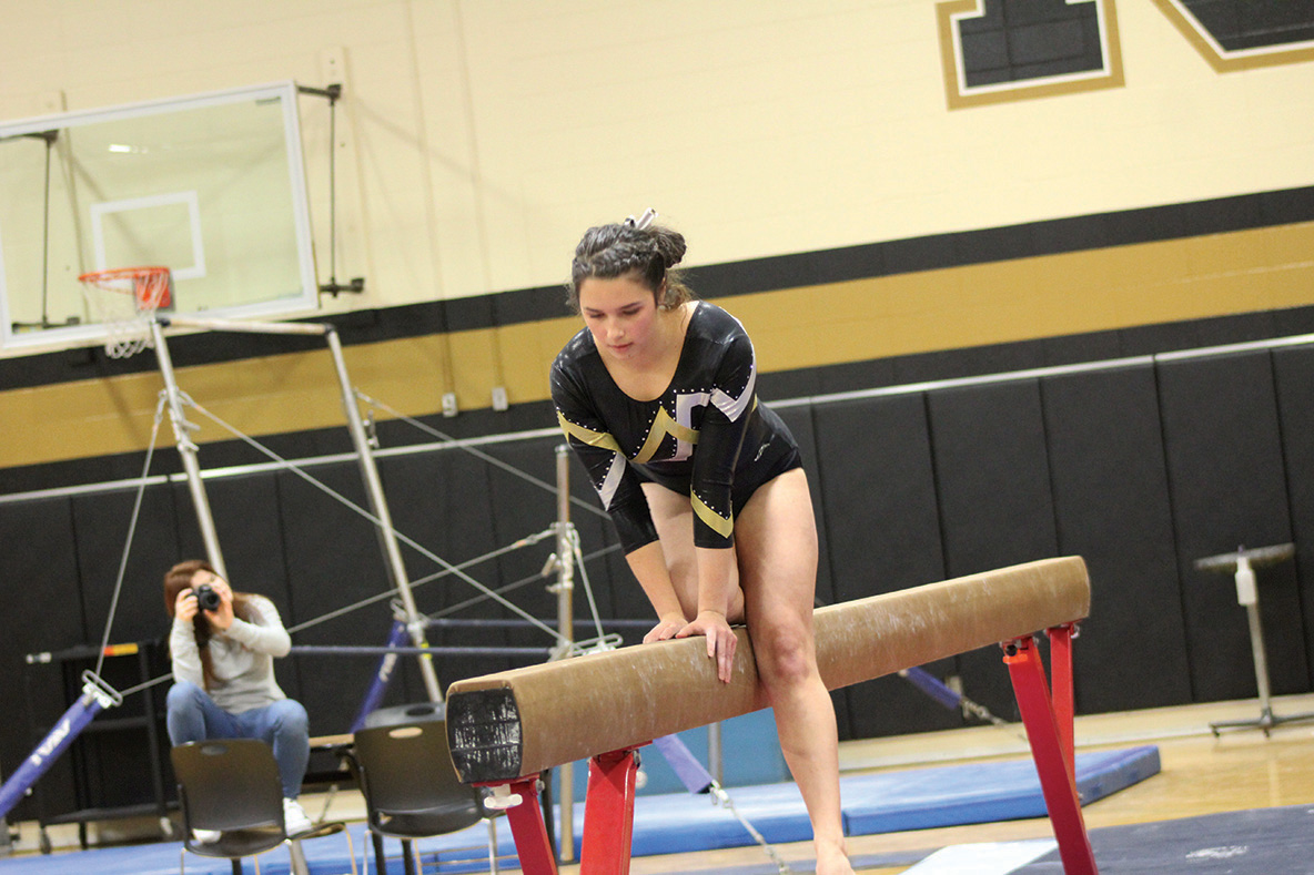 Mangin in the middle of her  beam routine.