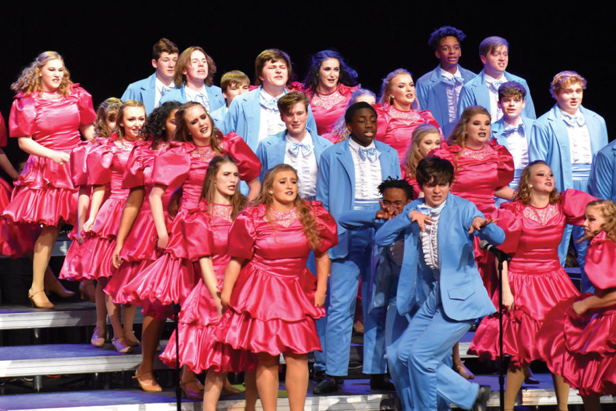 Singers performing at the Fishers show choir competition. The groups theme for their set is 'The Wedding Singer.'
