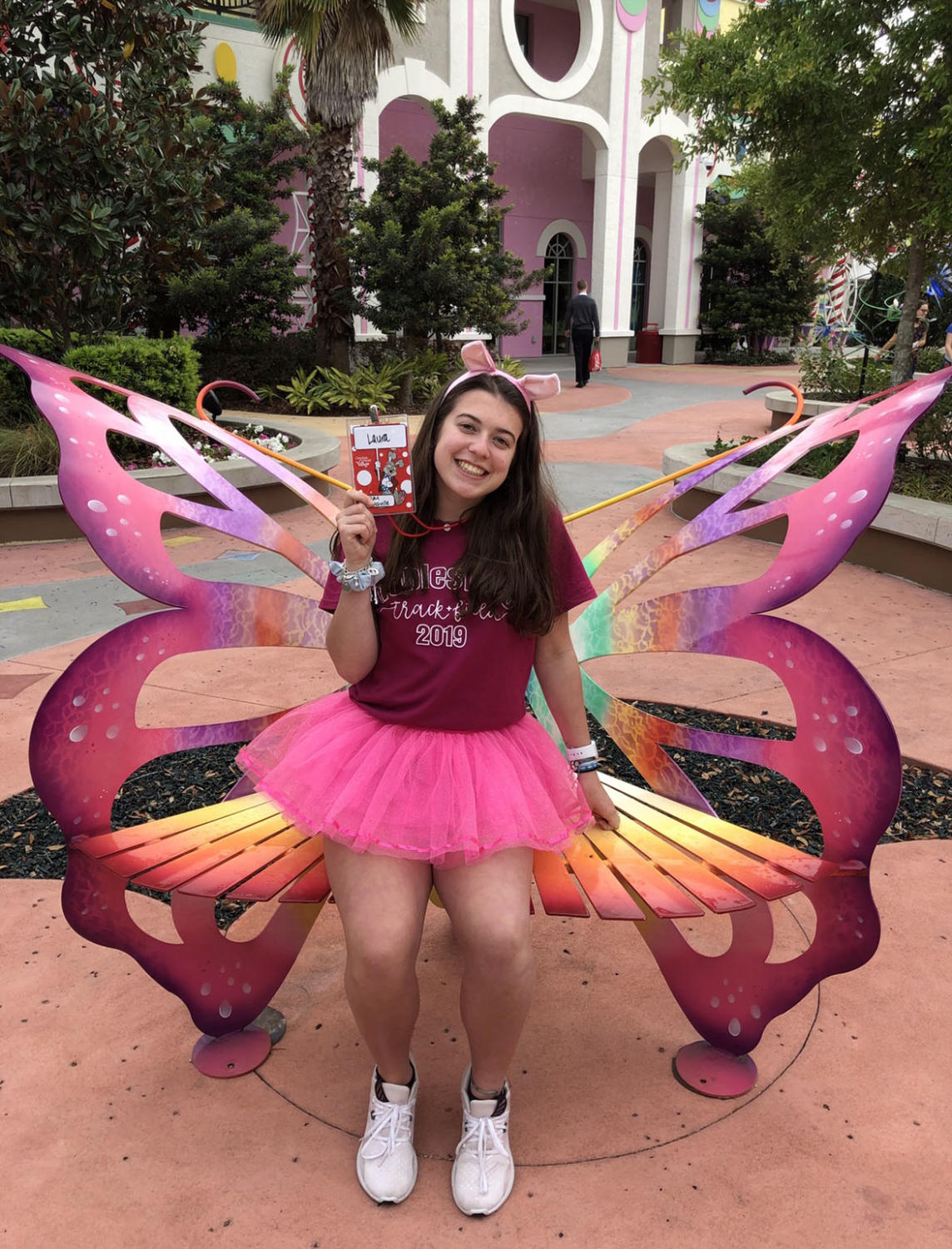 Claussen sitting on a butterfly bench at Give Kids the World. She visited GKTW for the second time this past spring break.