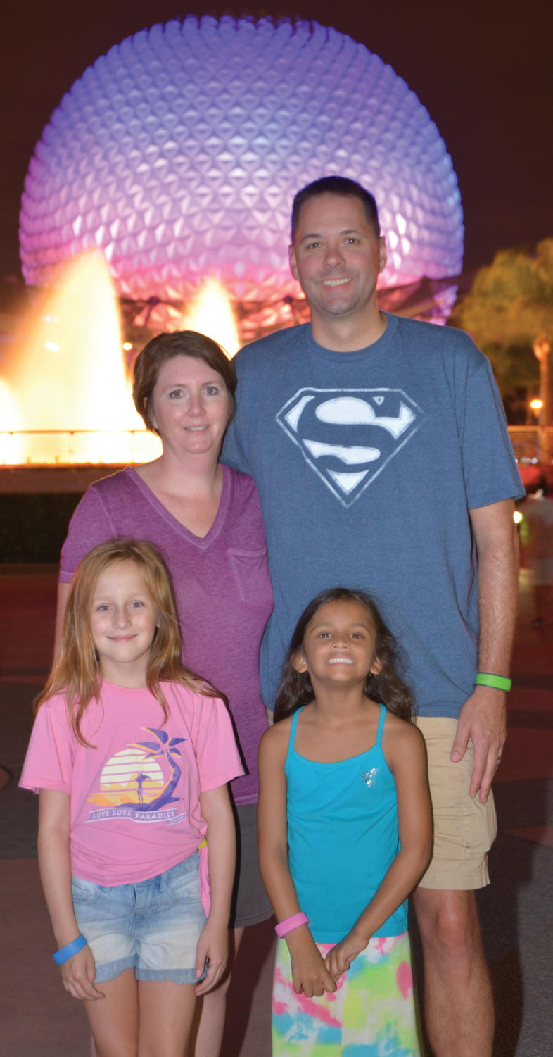 Dr. McCaffrey and family in Disney World.