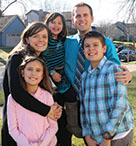 Andrew Wilkins with his family after they adopted Deanna. He is with his wife, Venessa, his son, Josh, and his two daughters, Ellie and Deanna.