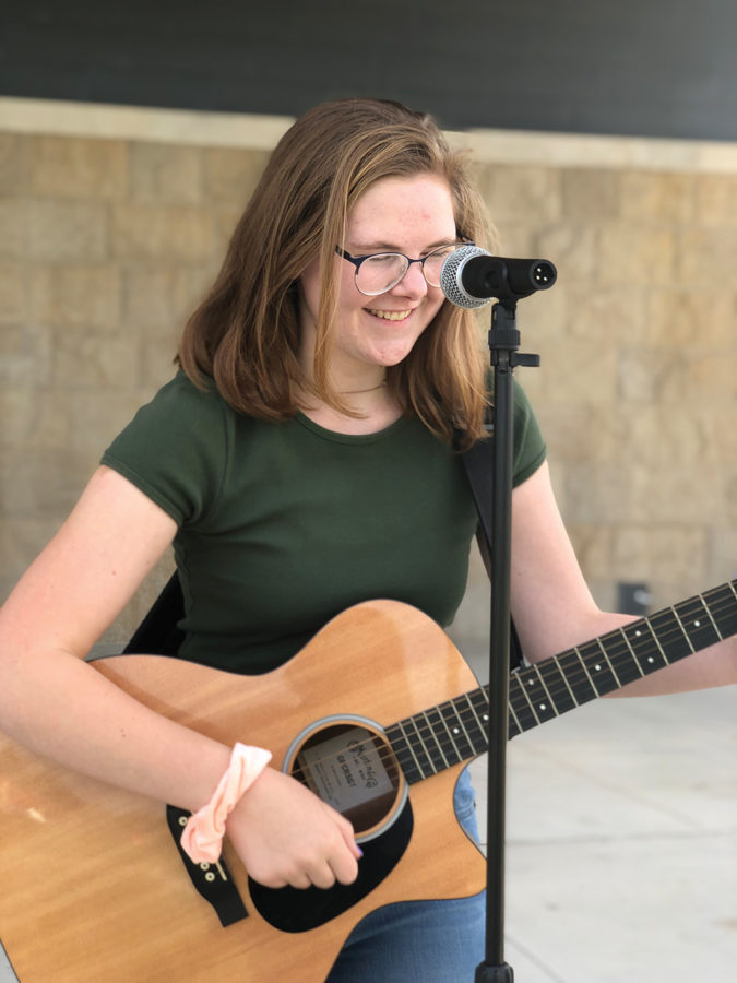 Lois Wielinski plays her guitar at the Federal Hill Commons.