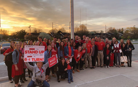 "A group of NHS forum members gather in front of the school to show their support for #RedforED. ""Our team has been working very hard with the district to come to an agreement that corrects the teacher pay issues here in Noblesville,"" teacher Amanda Giordano said."