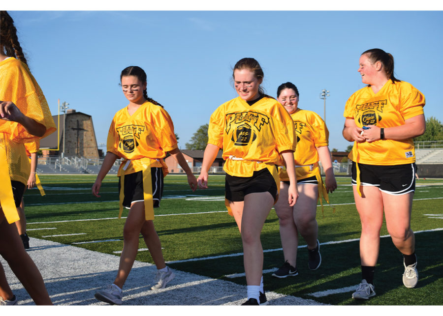 The sophomore Powderpuff team walks off Beaver Materials field in disappointment. They lost to the freshmen powderpuff team.