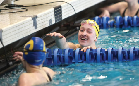 Sammy Huff, NHS-100 breast sectional champion and state cut, reaches out to MacKenna Lieske from CHS.