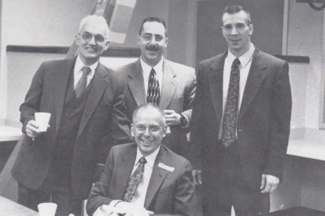 Dellinger on the day of his retirement in 1997. Powers and Dellinger's other coworkers marked the occasion by dressing up and styling their hair just like Dellinger.