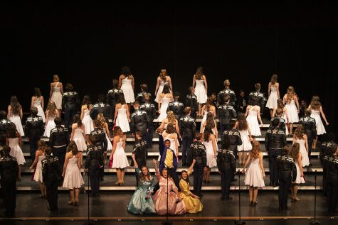 Dancing into the winning circle: NHS varsity show choirs are grand champs after their first competition