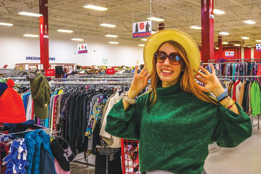 Rudy tries on a fashionable pair of sunglasses and a hat in the  Salvation Army in Noblesville. Rudy enjoys shopping secondhand and expressing her personality with what she finds.