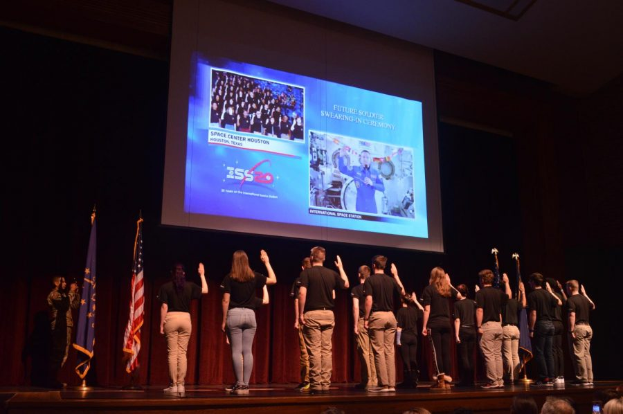 Taking the oath: NHS students are sworn into the military... from space