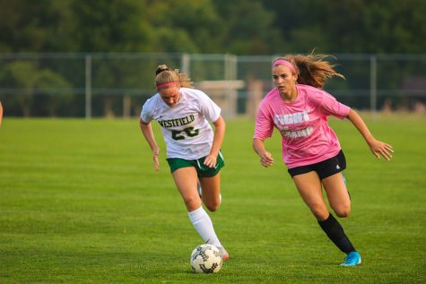 Kiana Siefert steals the ball from the opposing team. As she sprints down field, she takes the ball to score.
