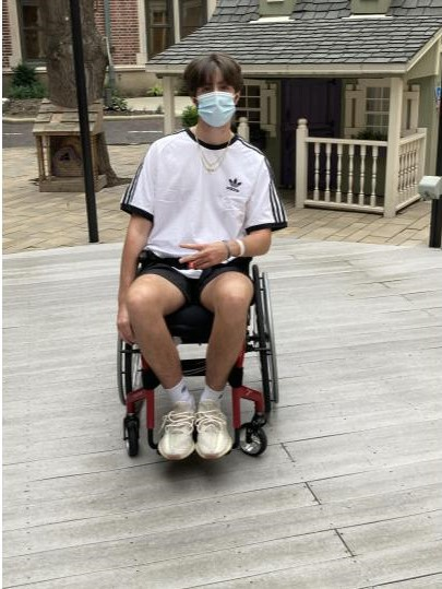 Shortly after being released from the hospital, Griffin Smith poses in his backyard. Smith's doctors are amazed at his progress.