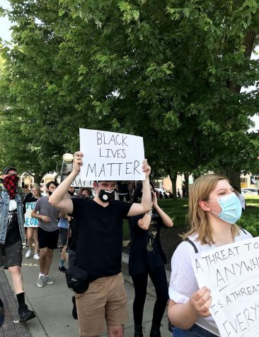 Equipped with signs and megaphones, NHS students took to the square to protest.