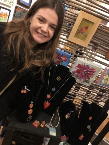 Madison Tomes shows off her handmade jewelry.