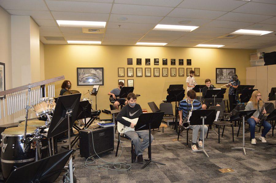 Jazz teacher Bethany Robinson's Jazz 4 class rehearses using their Plexiglass stands.