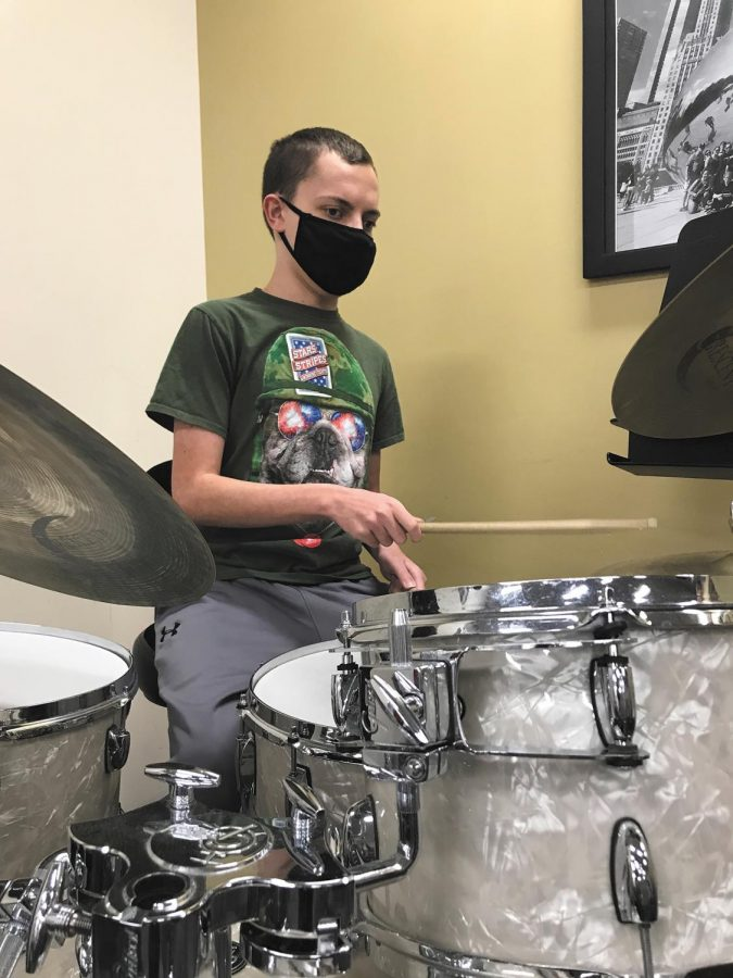 Sophomore Nate Taylor is a drummer for the NHS Band and Jazz Band. When he's not playing for the band, Taylor is writing and recording his own music.