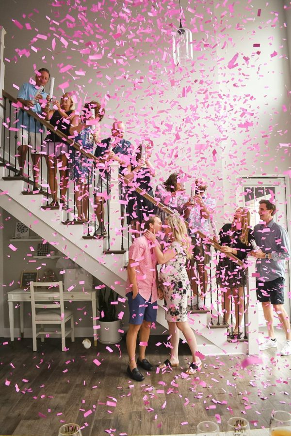 Lindsay Ray is pictured with her husband and close family. Ray's family utilized confetti to reveal the baby's gender at the  gender reveal party.