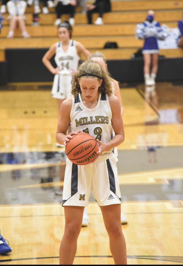 Ashlynn Shade prepares to shoot a free throw at NHS's home game against Hamilton Southeastern. The Lady Millers won 50 to 39. Photo provided by Ashlynn Shade