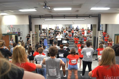 O'Dowd helps lead the NHS Singers in yoga. The Singers are one of the four show choirs at NHS.